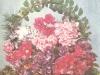 Аранжировка из различных сортов сенполии фиалкоцветковой в декоративной корзиночке